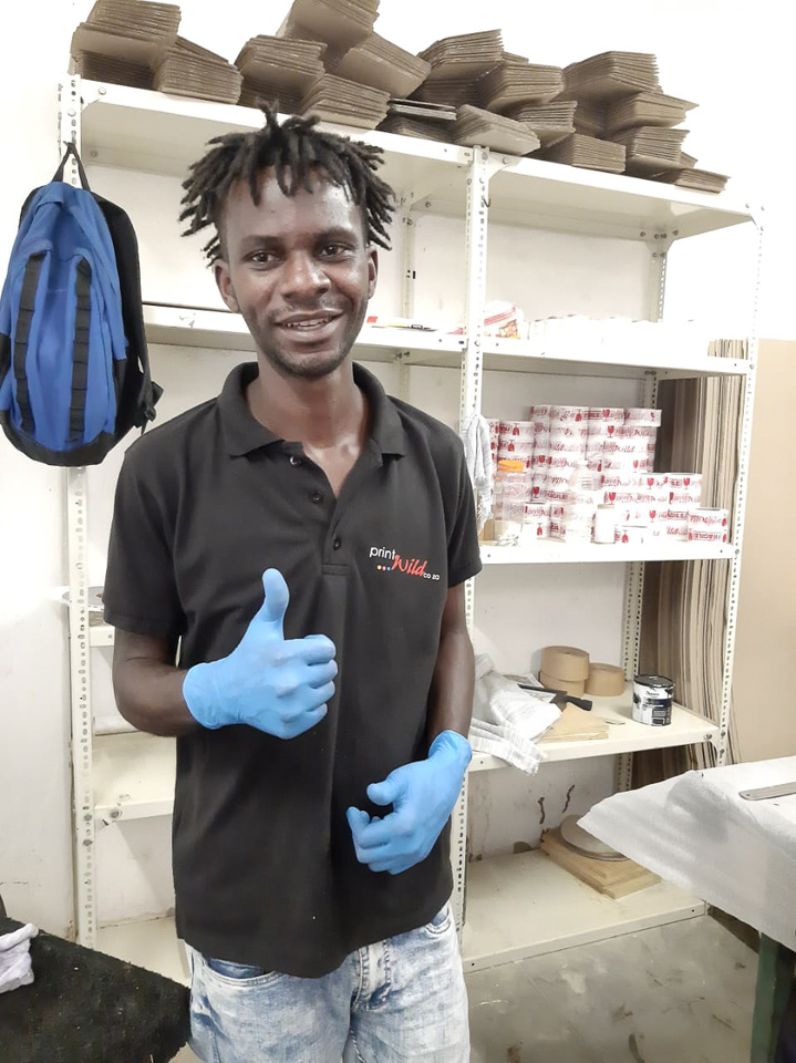 Happy Printwild worker showing a thumbs up